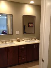 Bedford house photo - Hall bath with double vanities