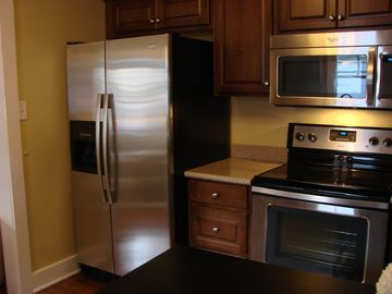 Huntsville house rental - Kitchen 1322 Wellman Ave-Brand new sink, appliances, and granite counter tops.