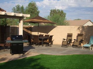 San Tan Valley house photo - Backyard Enjoy having a meal outside or lounging around soaking up the sun