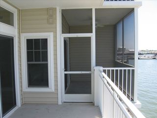 Crisfield condo photo - Enjoy Spectacular Sunsets From The Screened Porch