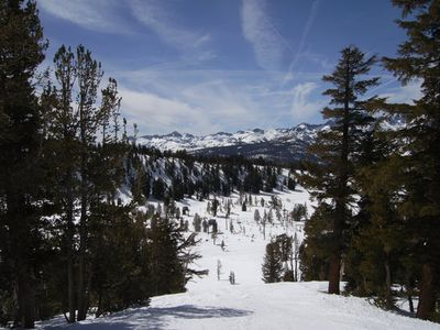 Mammoth Lakes condo rental - skiing at Mammoth Mountain - blue skies and beautiful Sierra views