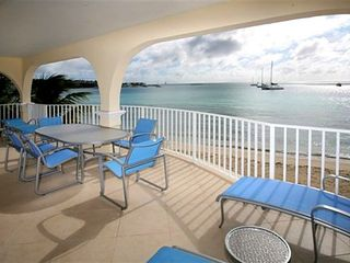 Simpson Bay condo photo - Covered veranda 9' x 35' with 4 chaise lounges and a dining table that seats 6