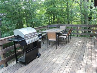 Big Bass Lake house photo - Deck with 4 burner gas grill and dining table