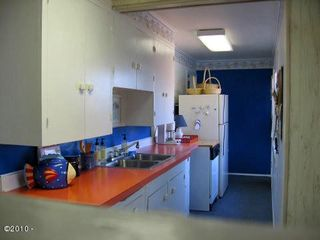 Galley style kitchen has everything you need. - Lincoln City house vacation rental photo