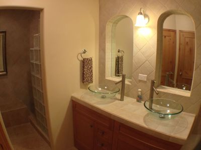 Rosarito Beach estate rental - Master Bathroom with 2 sinks, Shower, private toilet room, and large bath tub.