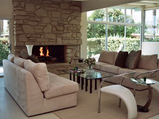 Rancho Mirage house photo - Living room and fireplace.