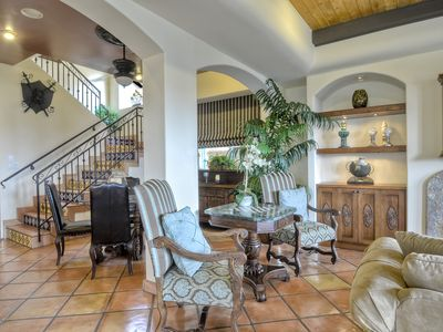 Oceanside villa rental - Dining to left w/ additional seating around fireplace and tv near sofa/sleeper