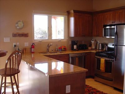 Kitchen w/Granite Counters, Stainless Appliances, W/D & Kitchenware