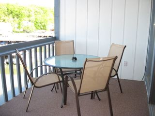 Osage Beach condo photo - Lakefront deck with 6 chairs and gas BBQ grill.