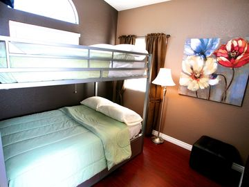 Bedroom 3 w/ Double Beds (bunk) and a roll out twin bed. (Sleeps 5) Upstairs