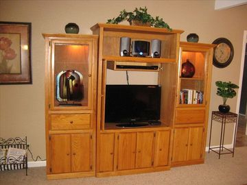 Living Room Entertainment Center with flat screen tv, DVD player and CD stereo.