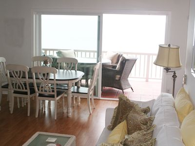 Spacious living room with unobstructed ocean views and flat screen HD TV