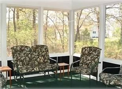 Bethany Beach house rental - View of the wooded lot from the screened-in porch