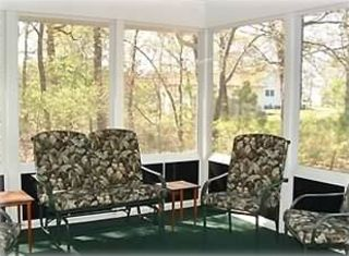 View of the wooded lot from the screened-in porch