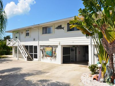 Front entrance, covered parking. A fun beachy fish-camp Key West feel here