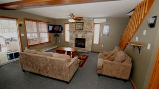 Lake Harmony Area house photo - 1st Floor Game Room with Flat Panel TV and Gas Fireplace