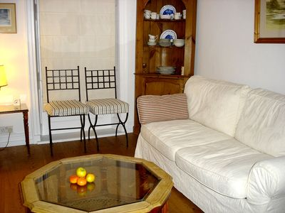 SITTING ROOM including a double king size convertible settee.