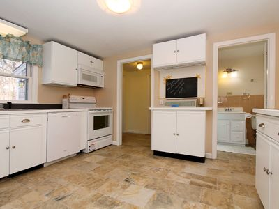 Spacious working kitchen with new appliances and ceramic tile.