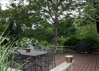 Brewster house photo - Large back deck has a charcoal grill and dining table.