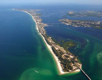 Aerial view of Island with bridges to longboat key and Bradenton