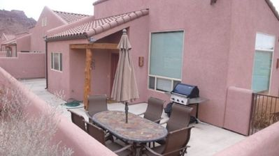 Moab condo rental - Patio with covered seating and grill.
