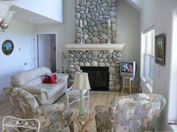 Higgins Lake house rental - Stone fireplace in family room