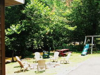 Pigeon Forge cabin photo - Fire pit, rocking chair, picnic table and playset are next to the creek