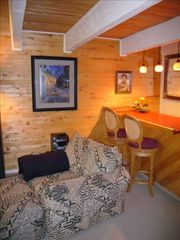 Steamboat Springs townhome photo - Elvis Wet Bar in Living Area seats two in the living room that seats 6 more.
