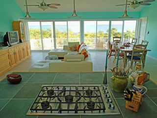 Great Exuma house photo - Fully equipped kitchen, looking into the living & dining room to the 60' deck.