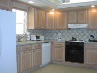 Captiva Island house photo - Renovated kitchen with tile backsplash.