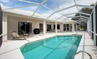 Vacation Homes in Marco Island house photo - Warm, Electrically Heated Pool; Southwest Sun!!