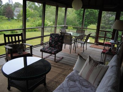 screened porch overlooking yard and conservation land