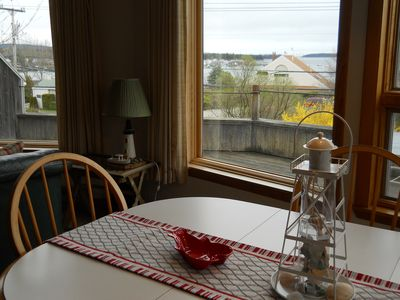 Gaze out at the harbor and outer islands from the dining table...