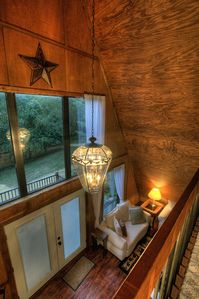 A favorite hangout for children: the carpeted loft overlooking the living room.