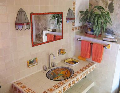 Each color-coded bathroom features traditional Talavera tile & stain glass lamps