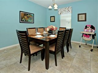Crystal Cove villa photo - Dinner table with 8 seats and high chair