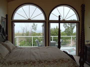 King size 4 Post bed with view of Lake Michigan