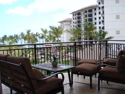 Lanai with view of the ocean, lagoon style pool and koi pond below.