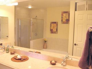 Master bathroom w double sinks & separate shower - Waikoloa Beach Resort villa vacation rental photo