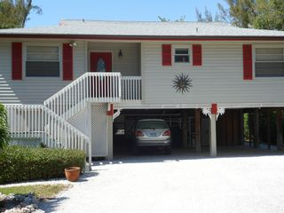 Sanibel Island house photo - Welcome to our home...enjoy the tropical heated pool and amazing view!!!