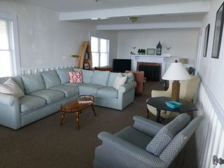 Monument Beach house photo - Living room: two seating areas. One looks out, the other faces TV.