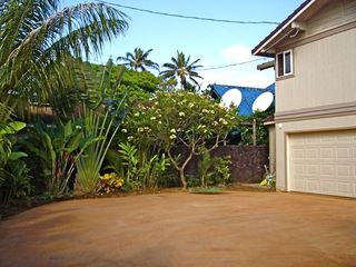 Sunset Beach house photo - Lush Landscaping & Parking in Driveway