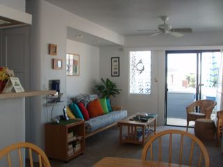 Mission Beach apartment photo - Bright living room open to deck & dining