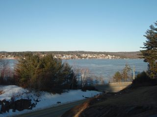 Laconia townhome photo - use the telescope to view boaters. or across the bay.