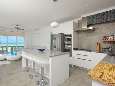 The ultra-modern kitchen with ocean views