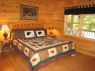 Gatlinburg cabin photo - Downstairs King Size bedroom with TV, DVD and VCR.
