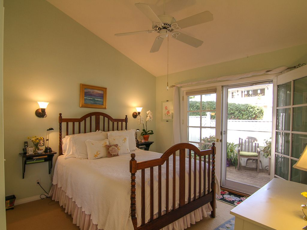 Queen size bedroom with outside deck.