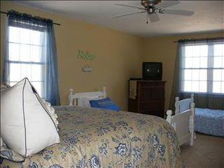 Eastham house photo - Second level Bedroom 2 is tastefully decorated and has a full and 2 twins.