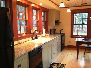 Stowe house photo - Granite Counters- Gleaming Wolfgang Puck Stainless Cookware