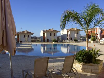 A superb modern bungalow with communal pools near the beaches and mountains